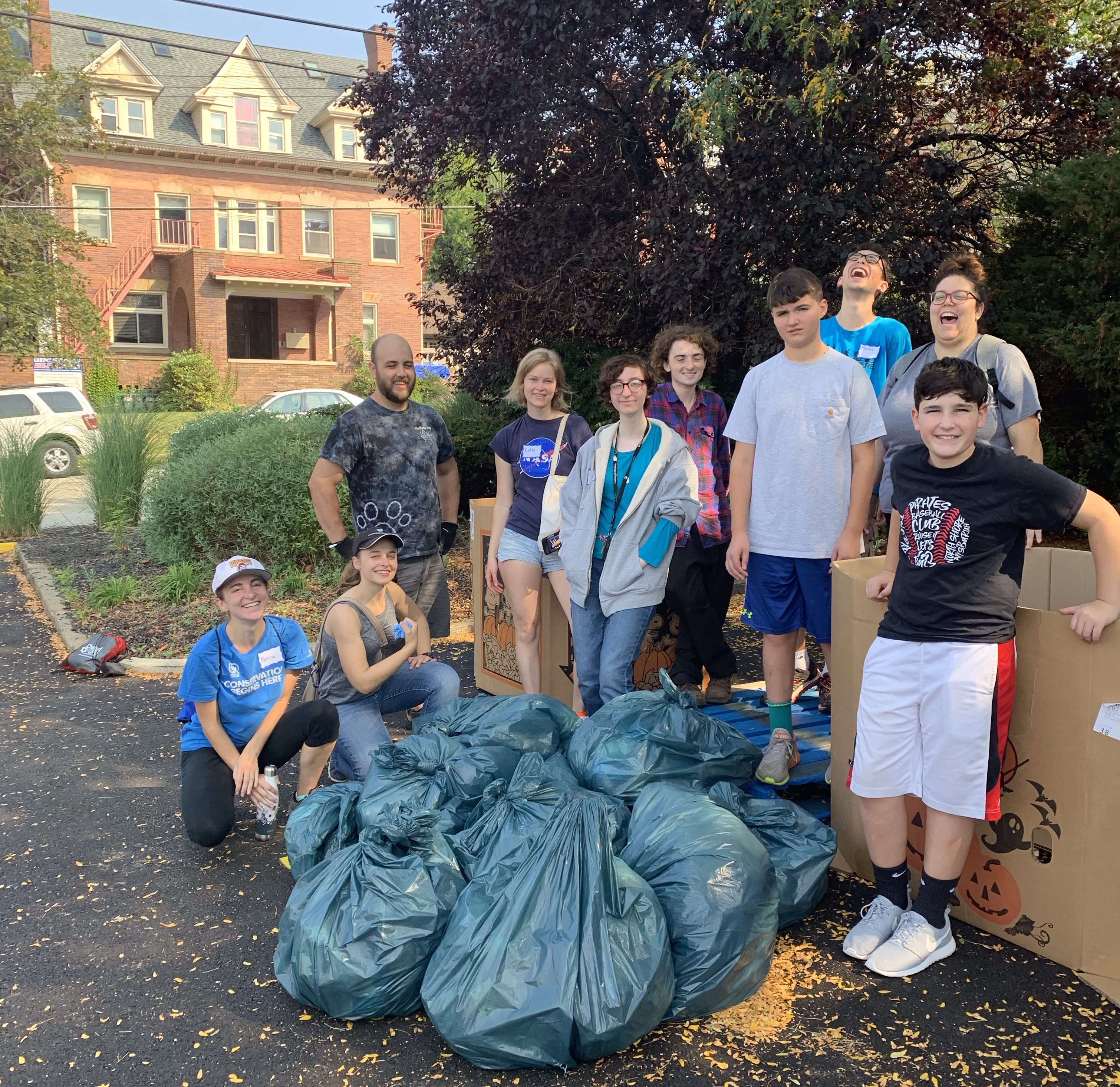 Photo of volunteers with trash bags in the Giant Eagle parking lot