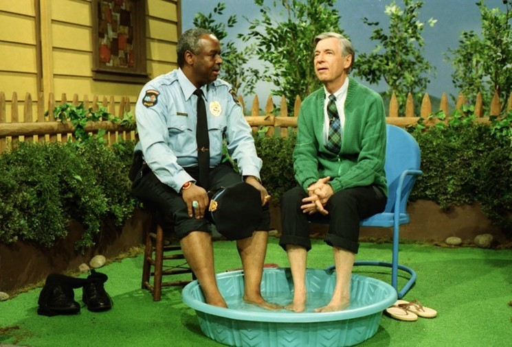 Mr. Rogers and Officer Clemmons cooling their feet in a shared kiddie pool